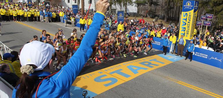 Jacqueline Benson shoots the starting piston for the elite womens start of the 117th running of the Boston Marathon, in Hopkinton, Mass., Monday, April 15, 2013. (AP Photo/Stew Milne)
